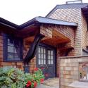 Front entryway with wood shingled sides and dark brown trim. From Facade Renovation in Piedmont, California designed by Susan L. Wootan