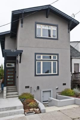 Photo of lifted Berkeley bungalow from the street after completion