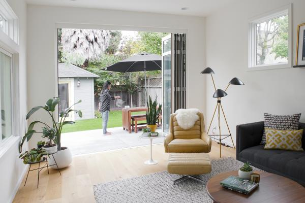 The Berkeley bungalow sliding glass doors open so the living room extends into the back yard